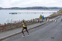 At the Great Orme/Llandudno Pier, approx. halfway - Elite and leading runners, 30 mins to 45 mins.